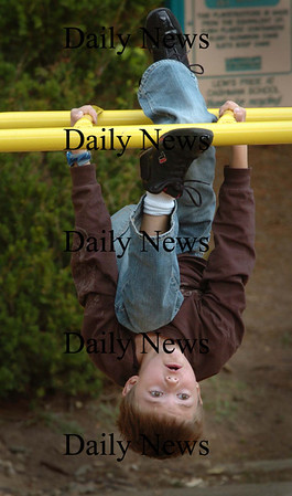 Amesbury: Aidan Keefe, 7, does some fancy acrobatics on the monkey bar at the Cashman School in Amesbury on Wednesday afternoon during recess. Bryan Eaton/Staff Photo