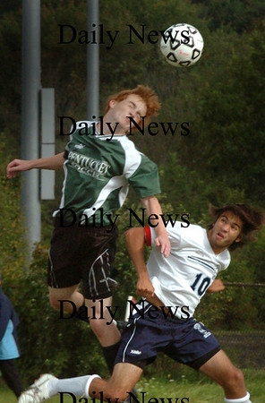 Byfield: Pentucket's Evan Miller and Triton's Justin Pacquette clash in action yesterday in Byfield. Bryan Eaton/Staff Photo Newburyport News Wednesday September 16, 2009.