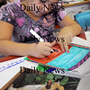 Amesbury: Brianna Sorgini, 9, draws a color picture of a dog in Linda Greenfield's art class at Amesbury Elementary School on Thursday afternoon. Students chose animals found in Mexico, which they've been studying in history, and the drawings will be sent to a company to be made into stickers to use as a PTA fundraiser. Bryan Eaton/Staff Photo Newburyport News  Thursday September 24, 2009.