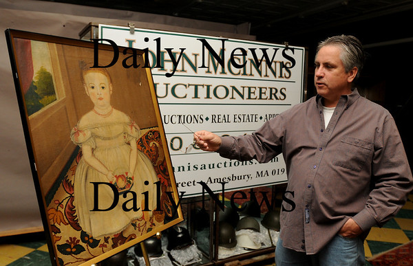 Amesbury: John McInnis gives tips on what people might have in their homes for auctions. Bryan Eaton/Staff Photo