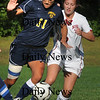 Newburyport: Clipper's Nicky Galer, right, moves in on a Lynnfield player. Bryan Eaton/Staff Photo Newburyport News Thursday September 24, 2009.