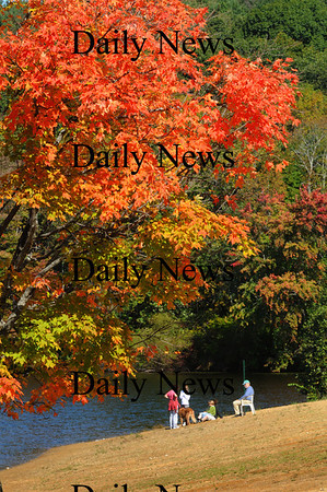 Amesbury: The leaves say fall, but the temperature said summer at Lake Gardner Beach in Amesbury where several beach-goers and canoeists were spotted yesterday morning.  Temperatures become a little more seasonal as the week goes on. Bryan Eaton/Staff Photo