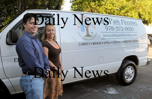 Groveland: Mark Foglietta, left, and Julie Schuck own Elm Park Flooring. Bryan Eaton/Staff Photo Newburyport News  Friday September 25, 2009.