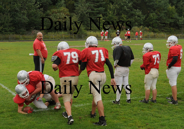 Amesbury: Amesbury High football team practices at the high school field on Wednesday afternoon. The threat over EEE isn't high enough in town allowing games and practices to continue. Bryan Eaton/Staff Photo Newburyport News Wednesday September 16, 2009.