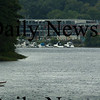Amesbury: A small boat catches yesterday's on the Merrimack River with Hatter's Point in Amesbury in the back. Bryan Eaton/Staff Photo  Newburyport News Tuesday September 22, 2009.