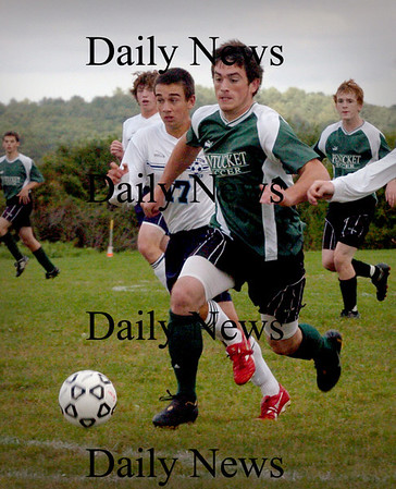 Byfield: Pentucket's Zach Brickett moves the ball to Triton's goal which was deflected. Bryan Eaton/Staff Photo Newburyport News Wednesday September 16, 2009.
