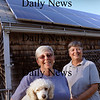 Newbury: LuAnn Kuder, left, and Maureen O'Brien, with AJ, have solar panels on their Newbury home. Their house is on a nationwide solar tour to showcase sustainable energy. Bryan Eaton/Staff Photo Newburyport News  Friday September 25, 2009.