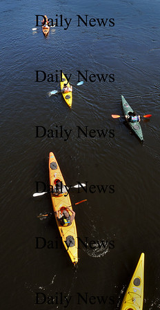 Amesbury: A group of kayakers pull from the under the Hines Bridge in Amesbury heading down the Merrimack River with a strong current Monday afternoon. Outdoor activities may be curtailed late Thursday and Friday as rain may come to the area. Bryan Eaton/Staff Photo Newburyport News  Monday  September 14, 2009.