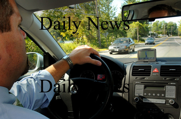 Salisbury: Brian Forget, business administrator for the Triton School District, uses a GPS mounted on his dashboard for personal and business use. Bryan Eaton/Staff Photo Newburyport News Tuesday September 15, 2009.