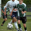 Byfield: Triton's Pat Martin moves in on Pentucket's Jake Benjamin. Bryan Eaton/Staff Photo Newburyport News Wednesday September 16, 2009.