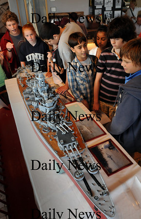 Newburyport: Nock Middle School eighth-grader and docent Dylan Wack, back left, explains the model of the USS Massachusetts at the Custom House Maritime Museum on Thursday to seventh grade students. He's a member of the World War II Club which meets after school and took the entire seventh grade to the museum to learn about era ships. Bryan Eaton/Staff Photo Newburyport News Thursday  September 10, 2009.