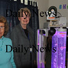 Newburyport: Jean Doyle, left, board of directors, and Ardis Campbell, president of the Society for the Relief of Aged Women donated a Vectra Distraction Station machine to Opportunity Works. Bryan Eaton/Staff Photo Newburyport News Thursday September 10, 2009.
