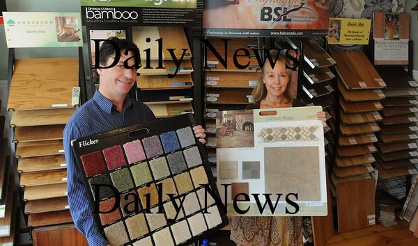 Groveland: Mark Foglietta, left, and Julie Schuck own Elm Park Flooring. Bryan Eaton/Staff Photo Newburyport News  Friday September 25, 2009.