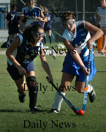 Georgetown: Georgetown's Hannah Birnie, right, tries to get the ball from a Hamilton-Wenham player. Bryan Eaton/Staff Photo Newburyport News Tuesday September 15, 2009.