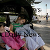 "Newburyport: Sisters Sofia Bellacqua, 1, and Gabriella, 3, take a little snooze along Newburyport's waterfront boardwalk Tuesday afternoon. The two, from West Newbury, were on a stroll with their ""Nana"" Peg Orlando of Newburyport. Bryan Eaton/Staff Photo Newburyport News Tuesday September 15, 2009."