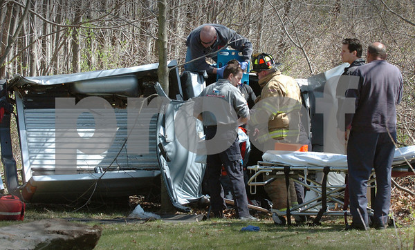 Salisbury: Rescue personnel remove the occupant of a pick-up truck that rolled over just north of Salisbury Elementary School entrance on Route One yesterday afternoon. The injured was taken by ambulance to Anna Jaques Hospital. Bryan Eaton/Staff Photo