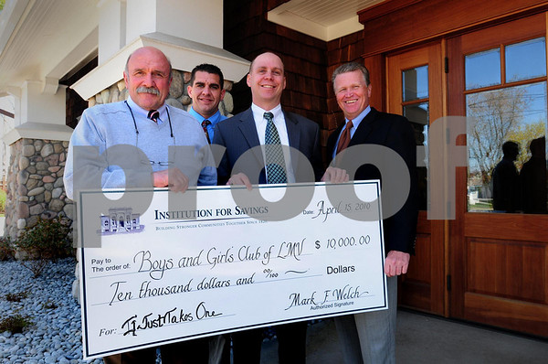 Salisbury: The Institution for Savings donated $10,000 to the Lower Merrimack Valley Boys and Girls Club to kick off a fundraising campaign to make up for the recent loss in state funding. From left, Dick Flaherty, co-founder of the club; Jason Cooper, operations director of the club; Michael J. Jones, executive vice presiden of the bank and Mark Welch, bank president. Bryan Eaton/Staff Photo