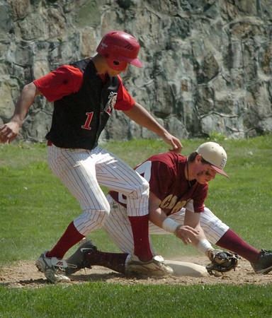 Newburyport: Amesbury's Joe Mejia scampers back to third as Newburyport's Matt Mottola gets the ball late. Bryan Eaton/Staff Photo