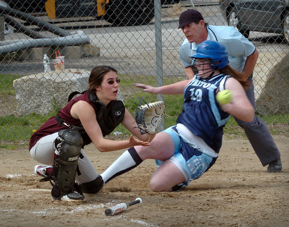 Newburyport: Newburyport catcher Cassandra Davis waits for the throw as Triton's Micaella Strangie makes it safely home. Bryan Eaton/Staff Photo