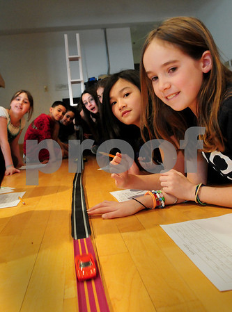 Salisbury: Fourth-graders as Salisbury Elementary School watch as a model race car slide down a track before making measurments of how far the car travelled. The students, in Brendan Stokes' tech class, let the cars start from different heights as they used math and science to learn about force, velocity and other physics principles. Bryan Eaton/Staff Photo