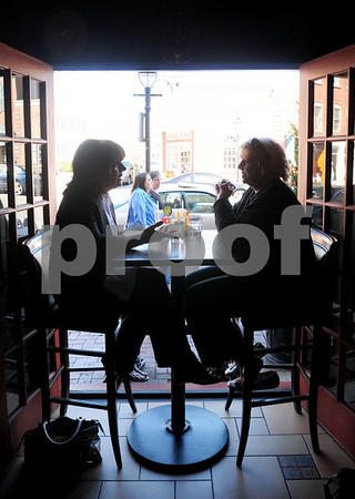 Newburyport: Debra Santa Anna, left, of Peabody, and Sheila Whicher of Rowley dine in the popular open-air table at Agave restaurant yesterday afternoon. Bryan Eaton/Staff Photo