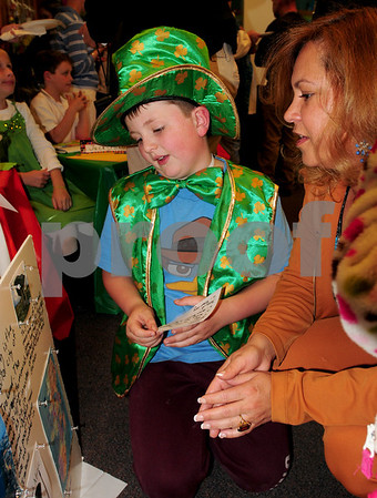 Newbury: Andrew Valianti, 11, shows his display of Ireland to Sandra Costonis at Newbury Elementary School on Wednesday during Passport Day in which students researched ancestors and made a presentation. Sandra's son, Nicholas, 8, also did a presentation as many parents attending the event. Bryan Eaton/Staff Photo