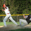 Amesbury: Newburyport National second baseman JT Leary is late with the catch allowing Swampscott's Chris Cole to make second base from first on a hit. Bryan Eaton/Staff Photo