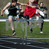 Amesbury: Pentucket's Andrew Saulnier, left, and Amesbury's Jay Giambarresi near the end of the 300 yard hurdles. Bryan Eaton/Staff Photo