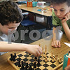 Amesbury: Jack White, 7, right, ponders his next chess move as classmate Liam Kelleher, 8, makes his. The two were in Elizabeth Morris's class at Amesbury Elementary School during game time which helps children play and get along with each other. Bryan Eaton/Staff Photo