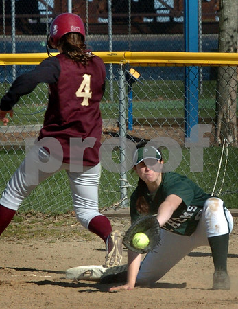 Newburyport: Pentucket first baseman Bernadette Corrado gets the ball late as Newburyport's Eleni Kacher is safe. Bryan Eaton/Staff Photo