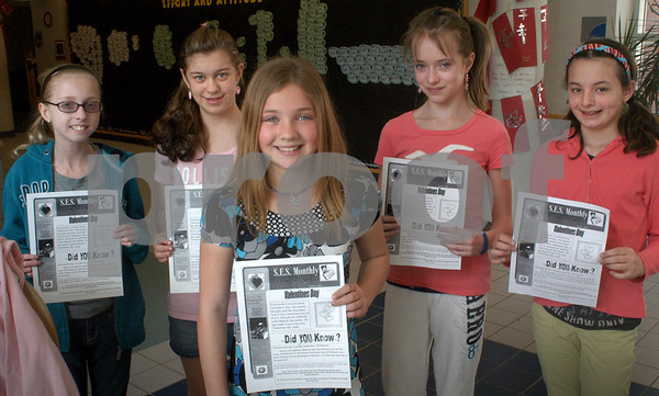 Salisbury: Students who have revived the Salisbury Elementary School Monthly newsletter, from left, Emily Winnerman, Briana Appolloni, both 12, Jenessa Doucette, 11, Lauren Mowles, 12, and Hailee Poulin, 11. Bryan Eaton/Newbuyport News