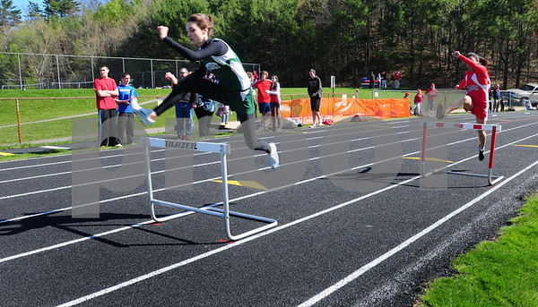 Amesbury: Amesbury High School's new track was inaugurated in a meet with Pentucket yesterday after a short ceremony with city and school officials attending a ribbon-cutting. Bryan Eaton/Staff Photo