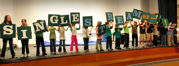 Newbury: Newbury Elementary School students spell out Single-stream Recycling during an informative and fun assembly which the school announced it's going to undertake. A group of students, parents, teachers and community members have formed a recycling committee and put on the show to show the importance and benefits of recycling. Bryan Eaton/Staff Photo