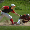 Newburyport: Newburyport's Sam Barlow is tagged by Amesbury third baseman Matt Enaire after being caught between second and third base. Bryan Eaton/Staff Photo