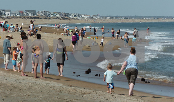 Salisbury: Temperatures close to 90 degrees brought a good amount of people to Salisbury Beach on Wednesday afternoon, several hitting the waves. Things cool down today with rain forecast for Friday and sun returning for the weekend. Bryan Eaton/Staff Photo