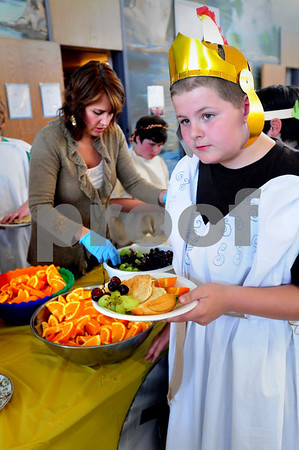 Amesbury: Dressed in a toga and helmet, Dylan Turcotte, 12, checks out the offerings at a feast during the Greek Festival at Amesbury Middle School on Tuesday afternoon. A member of Corinth city-state, his team won games earlier in the auditorium and was the first to head to the feast. Bryan Eaton/Staff Photo