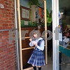 Newburyport: Kim Coppinger opens the screen door at Gram's Ice Cream for her daughter Ruby, 6, yesterday afternoon. Bryan Eaton/Staff Photo
