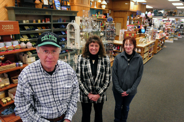 Newburyport: Jack O'Connor, owner of The Card and Gift Shop on Pleasant Street in Newburyport, shown with two longtime employees, manager Gale Meserve and Kristine Kelleher, is closing his store. Bryan Eaton/Staff Photo