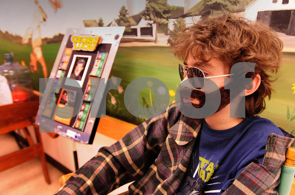 Amesbury: Ben Wetherbee plays the part of movie director and producer George Lucas during the Cashman School Wax Museum on Thursday. Fourth-graders researched ancient or contemporary figures to learn about and present to other students in the school, who would push a button for the character to come to life. Bryan Eaton/Staff Photo