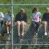 Newburyport: Newburyport High baseball fans sit safely behind the fence while watching their team take on Amesbury yesterday morning. The fans enjoyed the weather, though their spirits dampened as their team fell to the Indians 3-2. Bryan Eaton/Staff Photo
