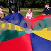 "Newburyport: Preschoolers from the Brown School sing ""This is the Way We Wash Our Clothes"" with a colored parachute on Wednesday morning. The children took a small field trip to nearby Atwood Park do several different activities in the nice weather. Bryan Eaton/Staff Photo"