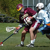 Byfield: Newburyport's Greg Schofield, left, battles it out with Triton's Pat Martin. Bryan Eaton/Staff Photo