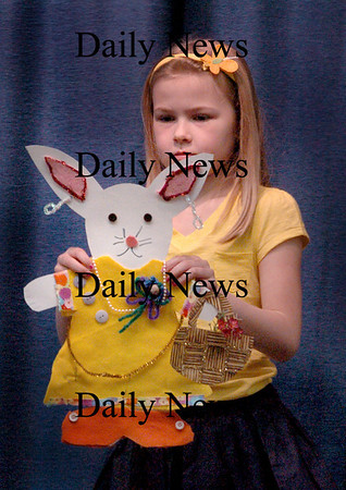 "Amesbury: Madlyn Creps, 7, shows off her ""Ashley Bunny"" at Amesbury Elementary School's ""bunny fashion show"" on Thursday. The multi-age classrooms created their own designs and wrote descriptions of their creations which were read out loud as they made their walk onto stage before parents and classmates. Bryan Eaton/Staff Photo"