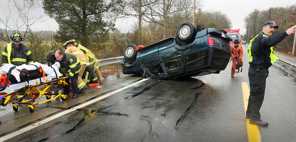 Newbury: Two people were injured in this rollover on Route One in Newbury just south of Boston Road just past 1:00pm yesterday afternoon. Bryan Eaton/Staff Photo