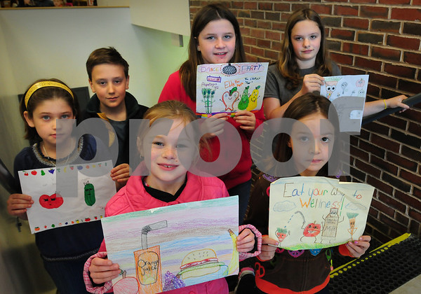 Amesbury: Winners of an art contest for National Nutrition Week show off their artwork which was sponsored by Chartwell's, the food service company at Amesbury Schools. Clockwise from left, Elena Sanborn, 8, Ben Jackson, 11, Michaela Halloran, 10, Aurora White, 12, Brieanna Hoggard, 7, and Rylee Dalton, 8. Daily News Photo
