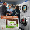 Salisbury: Ted and Mary Ellen Krohner of Newbury talk to Bill Richard's of Richard's Maytag in Salisbury about different washing machines. They are looking to take advantage of the state's energy rebates for appliances. Bryan Eaton/Staff Photo