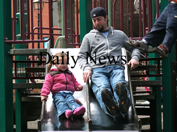Newburyport: Riley Freeman, 1, and her dad Josh, enjoy the slide at the tot lot on Inn Street in Newburyport, Monday afternoon. Photo by Ben Laing/Staff Photo