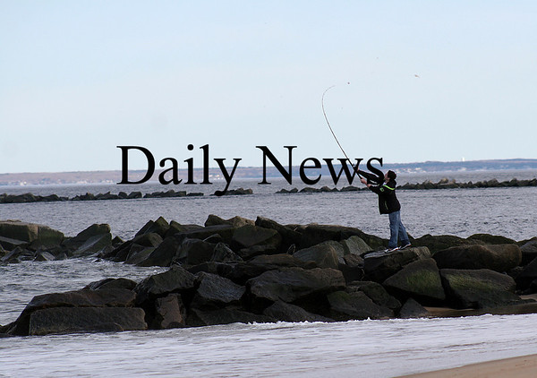 Salisbury: A young fisherman casts from the jeti at the Salisbury Beach Reservation Monday afternoon.Photo by Ben Laing/Staff Photo