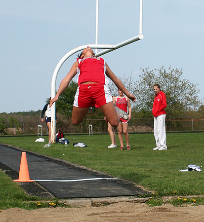 Byfield: Amesbury's Katara Harding takes off during the long jump event at Wednesday's track meet at Triton. Photo by Ben Laing/Staff Photo