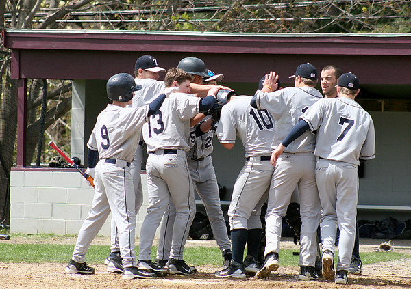Newburyport: Trtion's Speicher (10) is congratulated by his teammates after hitting a home run early in Wednesday's game against Newburyport. Photo by Ben Laing/Staff Photo